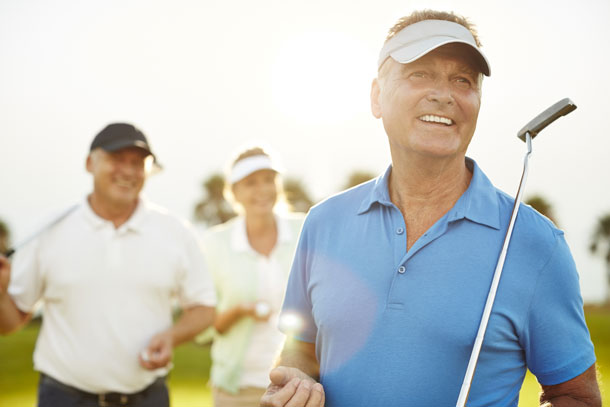 Mature men on golf course